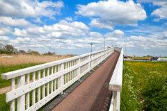 Long white bridge over river Stock Images