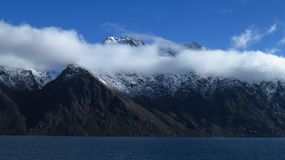 Long White Cloud Covering a Mountain Range. Aotearoa is the Māori name for New Zealand, meaning `the Land of the Long White Cloud royalty free stock photo