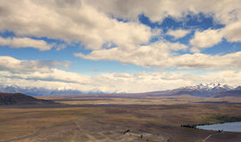 Long white clouds observed from Mt John observatory point. Royalty Free Stock Images