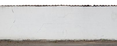 Long white cracked plastered wall and fence  isolated fragment. Stock Photo