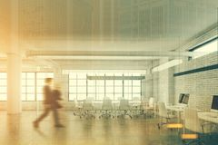 Glass meeting room interior, front view, people. Long white table and white armchairs standing in a glass conference room with tall windows. An open space office Stock Images