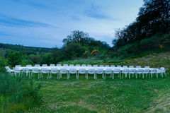 A long white table in the lawn Royalty Free Stock Image