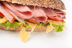 Long whole wheat baguette sandwich Royalty Free Stock Image