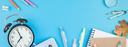 Long wide banner back to school concept. Creative flat lay top view back to school concept with color school and office supplies on bright turquoise paper table royalty free stock image