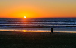 Beach in Agadir city at sunset, Morocco. Long, wide beach in Agadir city at sunset, Morocco Royalty Free Stock Image