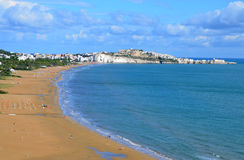 Long and wide beach in Vieste town. Gargano, Italy. Old town of Vieste in the background royalty free stock photos