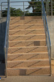 Long wide flight of outdoor steps with stainless steel handrails Royalty Free Stock Photography