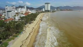 Long Wide Sand Beach between Ocean and Park Upper Panorama. Upper panorama long wide sand beach with garbage heaps between ocean and tropical park after stock video