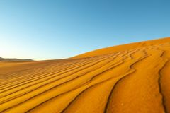 Long wind formed ripples with shadow defined edges in dunes of H. Idden Vlei, Sossusvlie Namibia royalty free stock photo