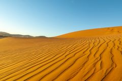 Long wind formed ripples with shadow defined edges in dunes of H. Idden Vlei, Sossusvlie Namibia Stock Image