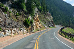 Long and Winding Curvy Mountain Road with Rock Slide Fencing Stock Images