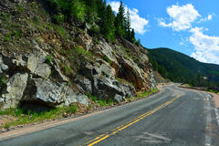 Long and Winding Curvy Mountain Road with Rock Slide Fencing Royalty Free Stock Image