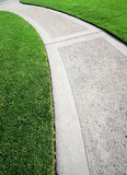 Long, Winding Road. Winding curved sidewalk and manicured green grass Stock Photography