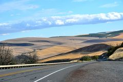 Long and winding road through the rolling hills of Central Oregon Royalty Free Stock Images