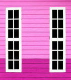 Long window white wood in the pink wall. Royalty Free Stock Photo