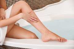Long Woman Legs. Beautiful Woman Cares About Legs. Depilation Royalty Free Stock Photography