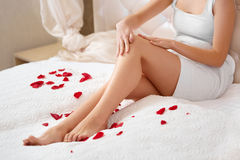 Long Woman Legs. Beautiful Woman Cares About Legs. Depilation Stock Photo