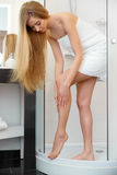 Long Woman Legs. Beautiful Woman Cares About Legs After Shower Royalty Free Stock Photography