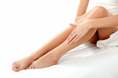 Long Woman Legs isolated on white. Epilation Stock Photo