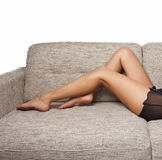 Long Woman legs in stockings on sofa Royalty Free Stock Images
