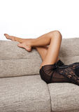 Long Woman legs in stockings on sofa. Sexy women legs on sofa Royalty Free Stock Photo