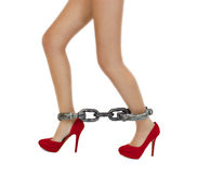 Long woman legs in stylish red shoes with shackles Stock Images