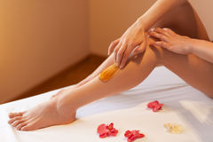 Long Woman Legs. Woman Cares About Her Legs. Sugaring Treatment Stock Photo