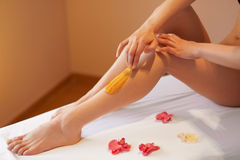 Long Woman Legs. Woman Cares About Her Legs. Sugaring Treatment Stock Image