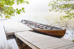 Long wood boat in a mist Royalty Free Stock Photo