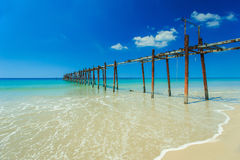 Long wood bridge on the beach with blue sky Royalty Free Stock Image