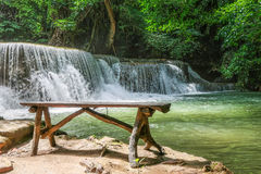 Long wood chair at the side of Huay Mae khamin waterfall in Nati Royalty Free Stock Photos