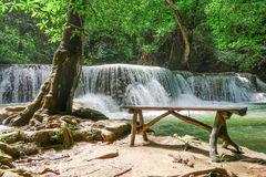 Long wood chair at the side of Huay Mae khamin waterfall in Nati Royalty Free Stock Photo