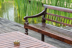 Long wood chairs and wood table Royalty Free Stock Image