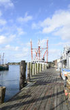 Long wood dock by a commercial pier Stock Images