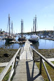 Long wood dock by harbor Royalty Free Stock Image