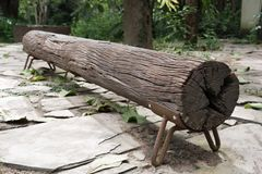 A long wood log outdoor bench. stock photo
