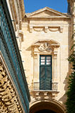 The long wooden balconies on the Grandmaster`s Palace, Valletta,. The long wooden balconies on the Grandmaster`s Palace over the Old Theatre Street, Valletta Stock Photography