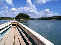 Long Wooden Boat Tropical River Royalty Free Stock Image