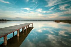 Free Long Wooden Bridge On The Lake, Horizon And White Clouds On Blue Sky In Staw, Poland Stock Photos - 169891763