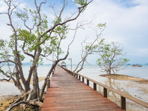Long wooden bridge into the sea Royalty Free Stock Image