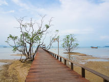 Long wooden bridge into the sea Royalty Free Stock Photography