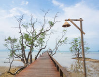 Long wooden bridge into the sea Royalty Free Stock Photos