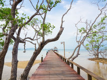 Long wooden bridge into the sea Royalty Free Stock Images