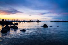 Long wooden bridge in tropical island beach at sunset Koh Mak Royalty Free Stock Photos