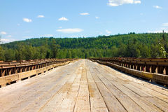 A long wooden bridge in the yukon territories. A sturdy vehicular crossing spanning a river in northern canada Royalty Free Stock Photography