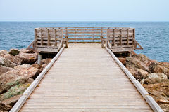 Long Wooden Dock with Observatory and View of the Ocean Royalty Free Stock Photo