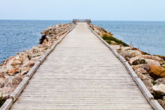 Long Wooden Dock with Observatory and View of the Ocean Royalty Free Stock Images