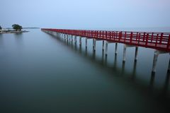 Long wooden jetty into the sea Royalty Free Stock Photography