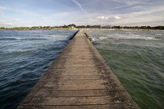 Long wooden ocean pier Stock Photo