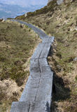 Long wooden path on the slope of the mountain Royalty Free Stock Photography